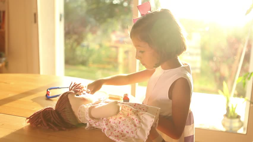 Girl Playing Doctors with Doll