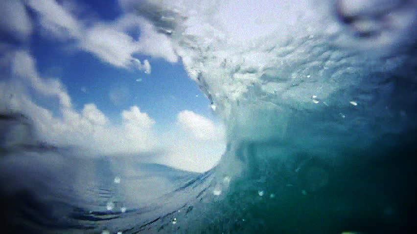 A wave barrels in slow motion, view from inside the tube