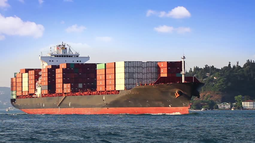 Large cargo container ship cruising under clear blue sky