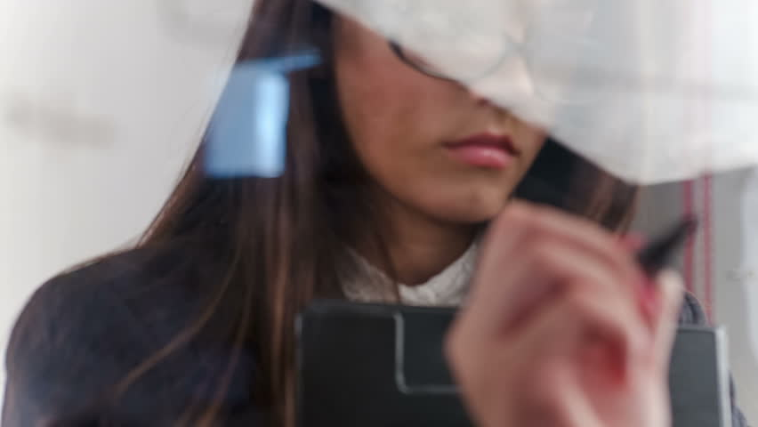 Female student writing math formulas. RAW video record.
