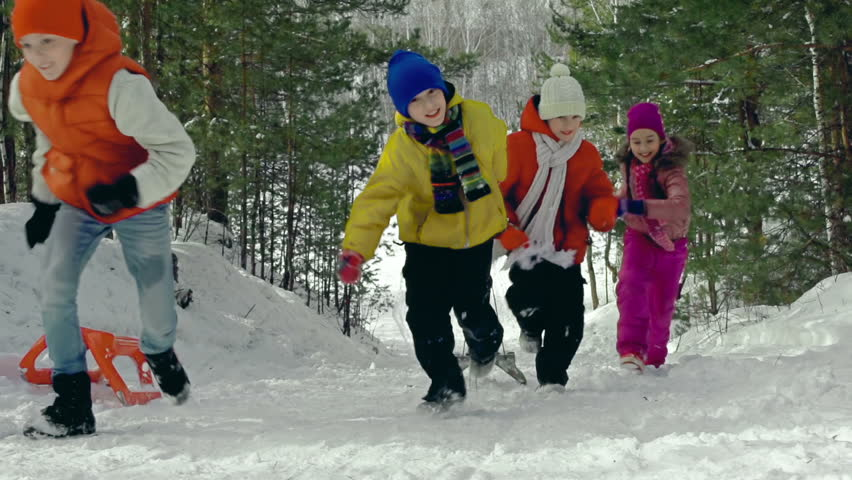 Kids running uphill with toboggans in slow motion - HD stock video clip