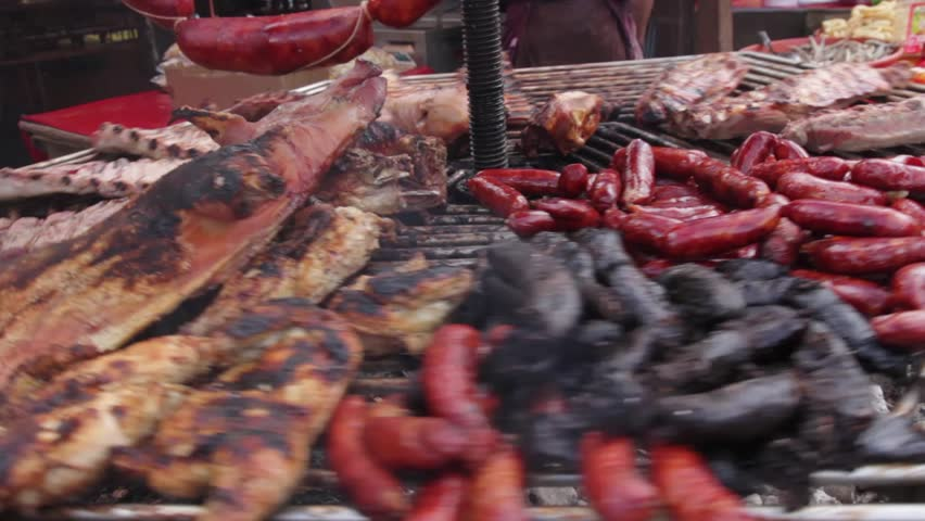 Turning Meat Grill - Grilled roast outdoors. Pork, beef, lamb, sausages, sausages and black pudding #7508161
