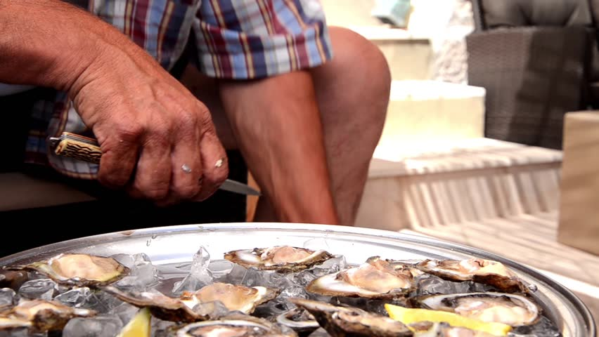 cleaning oysters - HD stock video clip