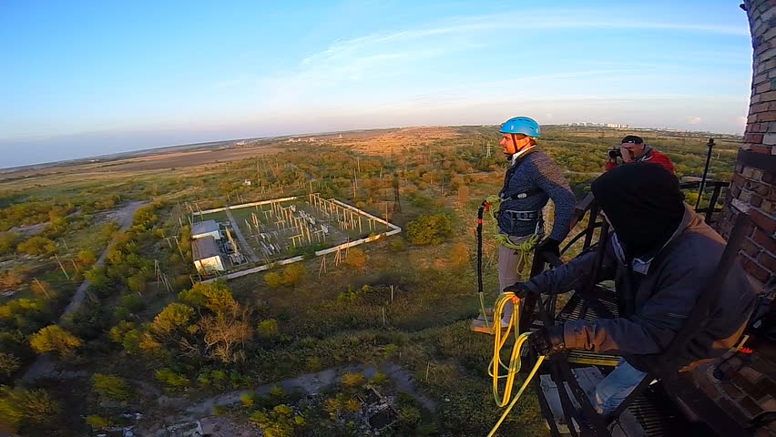 Ropejump from the old factory chimneys in Krasnodar, a height of 80 m amplitude coast 60 m hangs 20 meters above the ground on a system of climbing ropes    Shutterstock HD Video #7519663