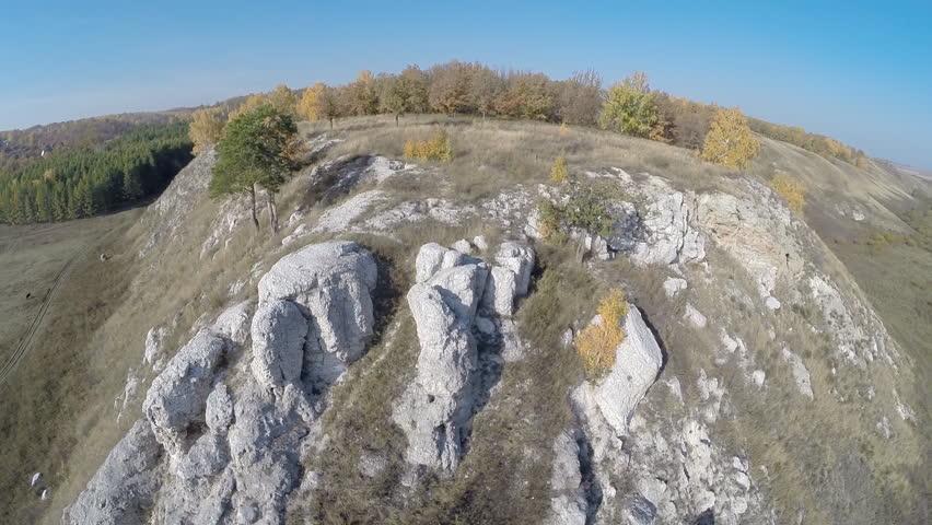 Aerial view. Flying over the rocky hill, autumn landscape. Bashkiria, Russia, Ufa  | Shutterstock HD Video #7529959
