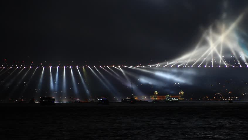 ISTANBUL - OCT 29 2013: Running lights on Bosporus Bridge. Loop. October, 29 festival in Istanbul. The country's largest October 29th fireworks display even has pyrotechnics shooting off the Bosphorus