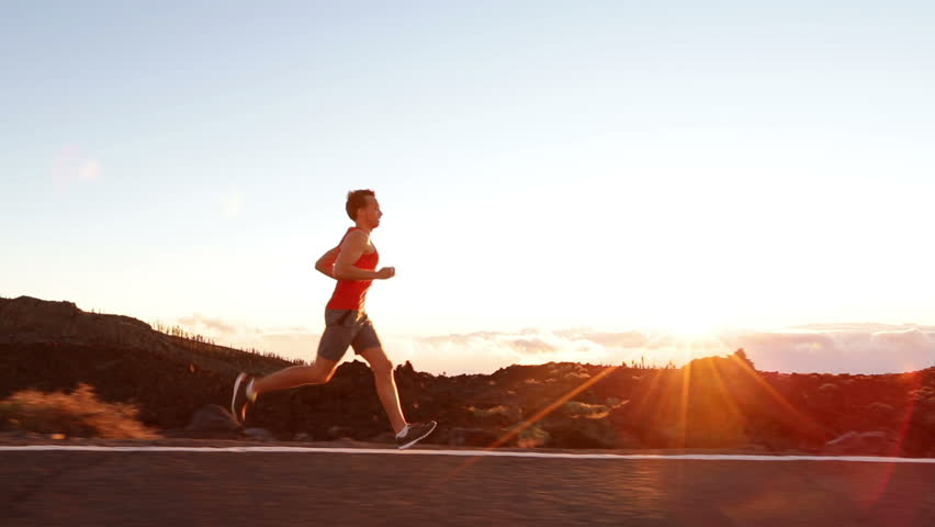 Running runner man athlete training outdoors exercising on mountain road at sunset in amazing landscape nature. Fit handsome athletic male working out for marathon run outside in summer. | Shutterstock HD Video #7587919