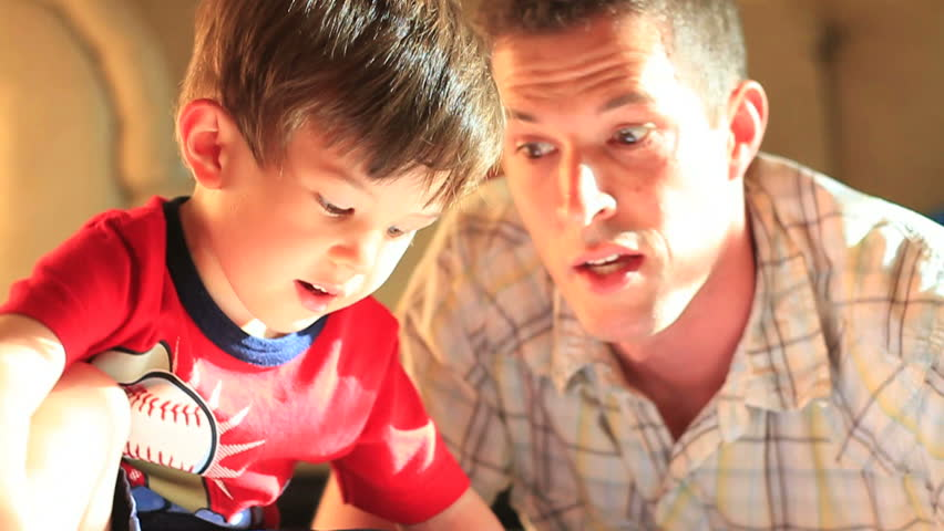 Father and Son Reading and laughing