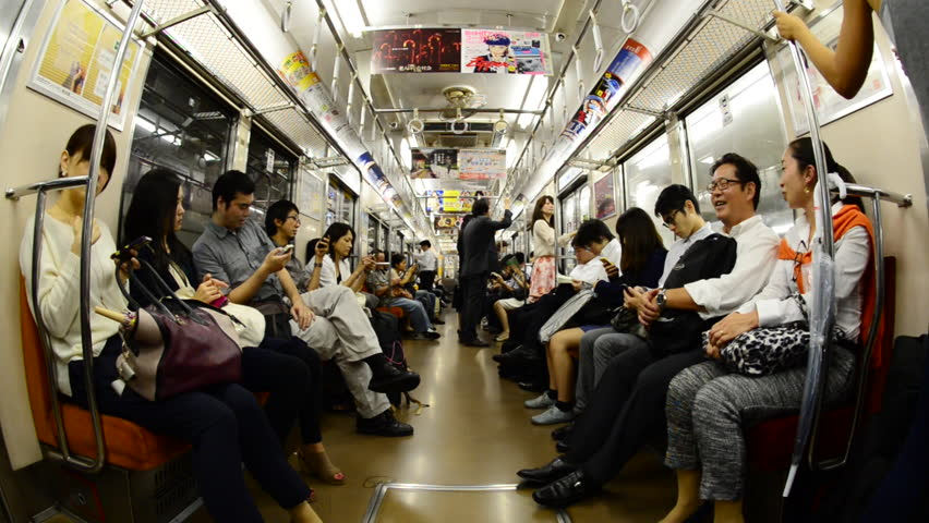 tokyo circa 2014 train passengers riding a busy subway car tokyo metro rail system circa. Black Bedroom Furniture Sets. Home Design Ideas
