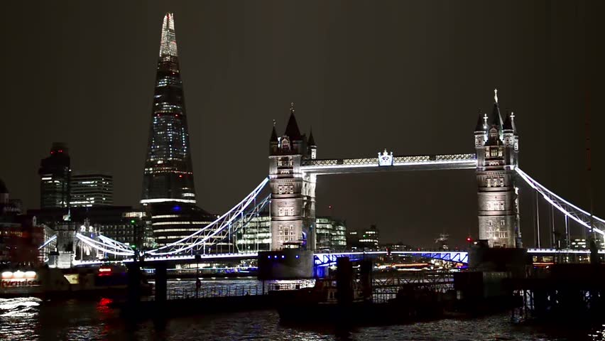 London night scape view of Tower Bridge and the Shard with thames river water reflections - HD stock footage clip