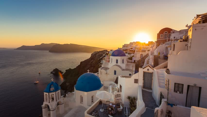 People watching sunset over beautiful town of Oia on the Island of Santorini, Greece | Shutterstock HD Video #7635412