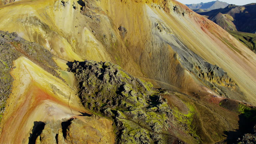 Aerial mountain view mineral colors steam venting volcanic active area thermal energy Landmannalaugar Wilderness travel Iceland RED EPIC - 4K stock footage clip