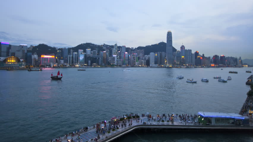 Time lapse Skyline Tsim Sha Tsui Promenade illuminated dusk to night view Victoria Harbour skyscrapers 2 IFC ship barge Financial district ferries China Asia   Shutterstock HD Video #7690663