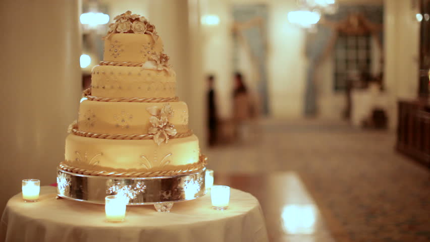 stocks bakery wedding cake a golden wedding cake at left with shallow depth of 20533