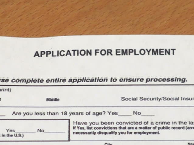 Job application form viewed through magnifying glass V2 - NTSC - SD stock footage clip