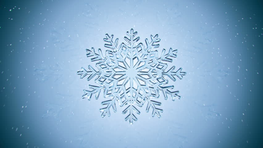 Big Christmas snowflake with snow on blue background. - HD stock footage clip