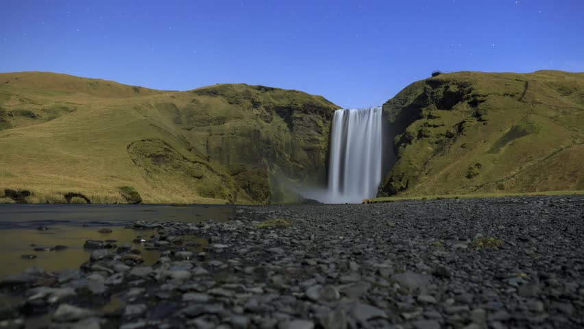 Skgafoss / Skogafoss, a powerful waterfall in southern Iceland.  Timelapse footage filmed by moonlight.