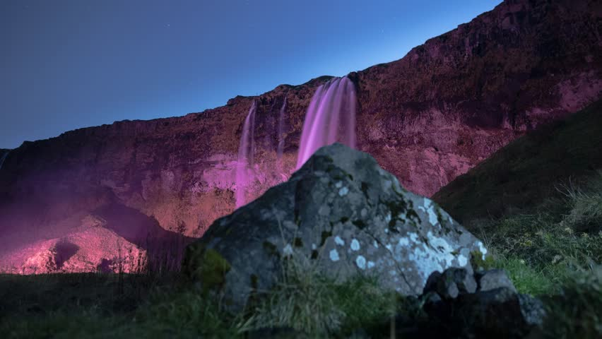 Seljalandfoss waterfall in south Iceland, at night.  Timelapse footage with motion controlled dolly movement.