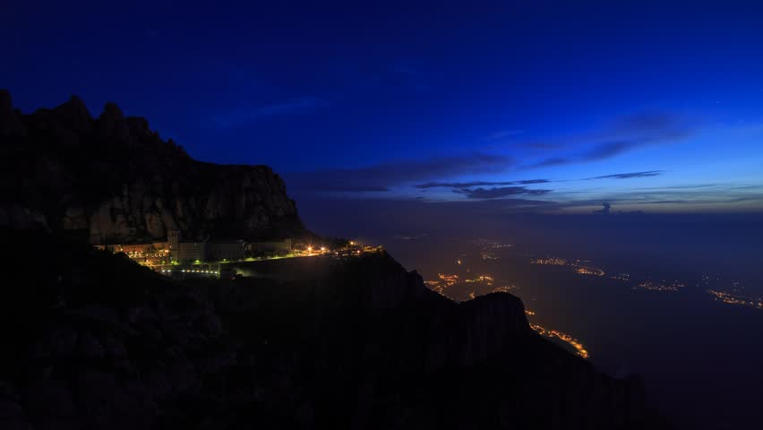 Monastery at Montserrat, timelapse footage, night to day transition with golden clouds after sunrise. 9 second, faster of 2 versions.