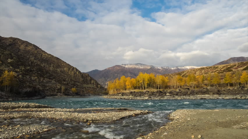 This video is about picturesque place in Altai mountain. Two rivers are connecting. Clouds above mountains is moving. It is Autumn gold light. Olympus EM-1, 1920*1080, 25 fps, f22, 12mm, iso100