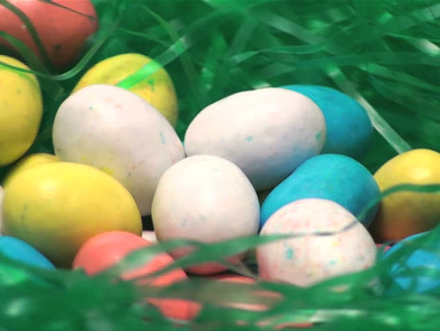 Easter egg candy in grass zoom - NTSC - SD stock video clip