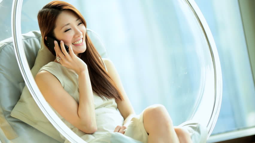 Young Asian Chinese female luxury apartment accommodation room relaxation wireless smart phone technology conversation | Shutterstock HD Video #7839523