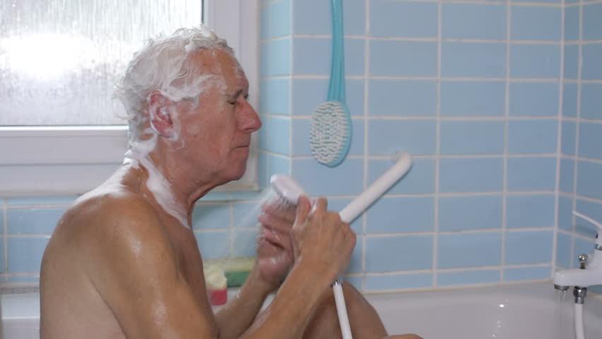 Senior Man Washing His Body With Bath Brush. Stock Footage ...