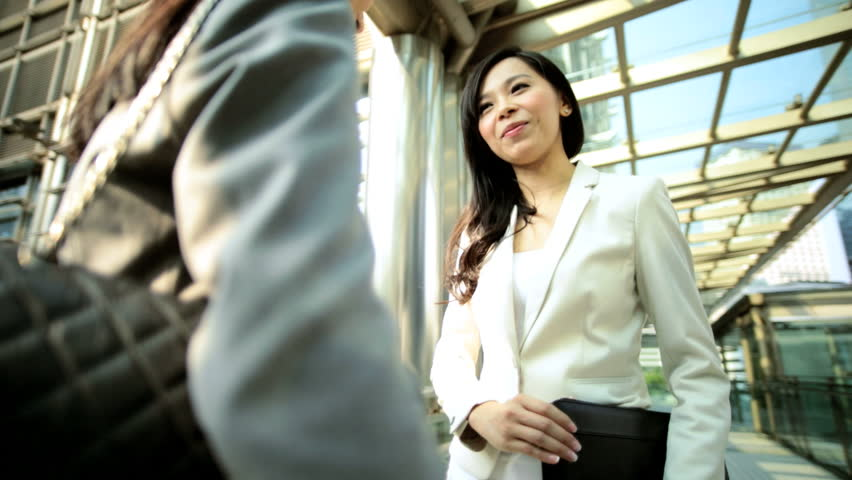 Young female American Asian Chinese businesswomen ambitious smart business suit outdoors city buildings financial district   Shutterstock HD Video #7851457