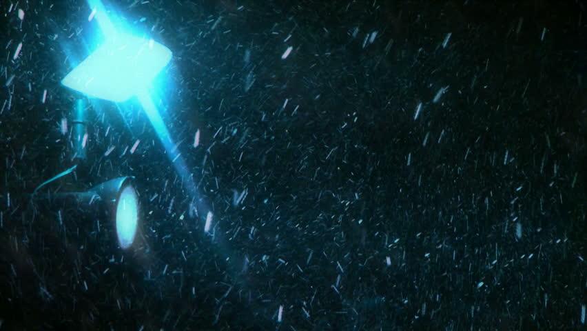 Snowfall blue. Snowfall is illuminated lantern blue light. Against the dark night. - HD stock footage clip