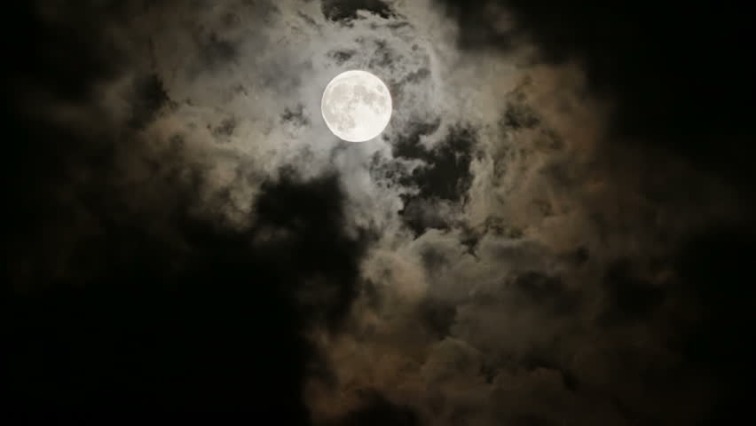 Full moon behind clouds at night - HD stock footage clip