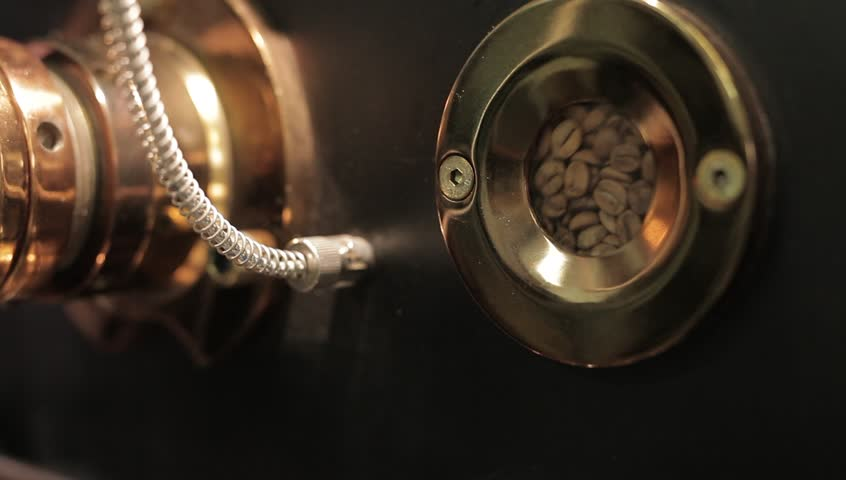 The freshly roasted coffee beans from a large coffee roaster. - HD stock footage clip