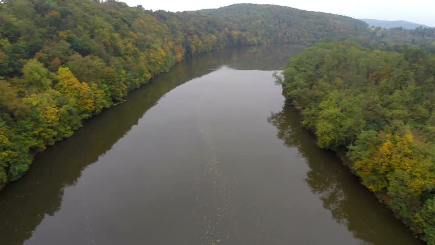 Calm river autumn aerial shot, fly above still water, brown | Shutterstock HD Video #7895728