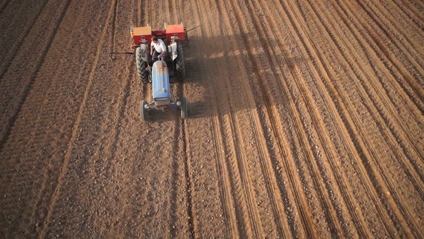 Aerial of tractor seeding/planting on the scenic panoramic view (close up) | Shutterstock HD Video #7898914