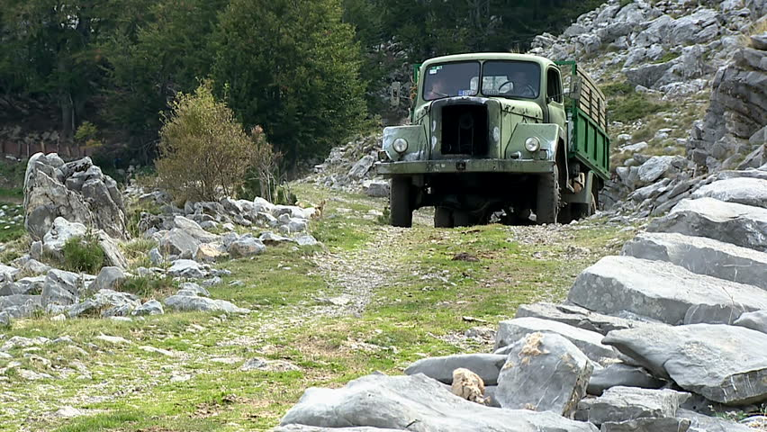 MONTENEGRO - KUCI 2009 - Old truck on a mountain dirt road - HD stock footage clip