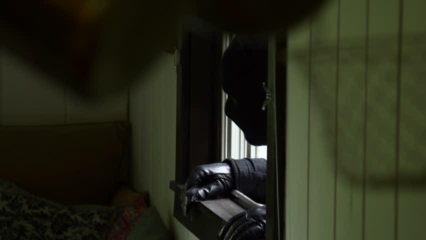 A burglar enters house through window - property released