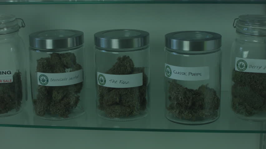 """MEDICAL MARIJUANA CONTAINER IS REMOVED FROM A DISPLAY CASE INSIDE A MEDICAL MARIJUANA DISPENSARY. VERSION 2. ALL LABEL ARTWORK WAS CREATED & CLEARED BY """"PROP HEAVEN"""" IN BURBANK, CALIFORNIA."""