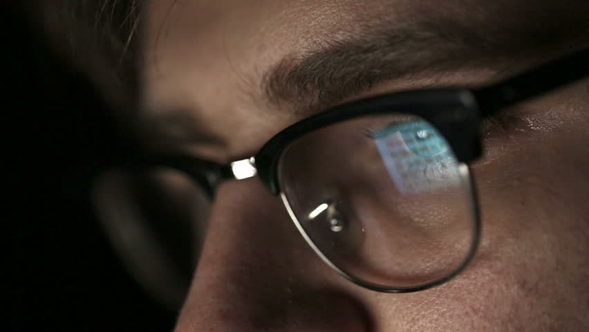 Portrait of a young man with glasses who works at night.  Close up   Shutterstock HD Video #8009119
