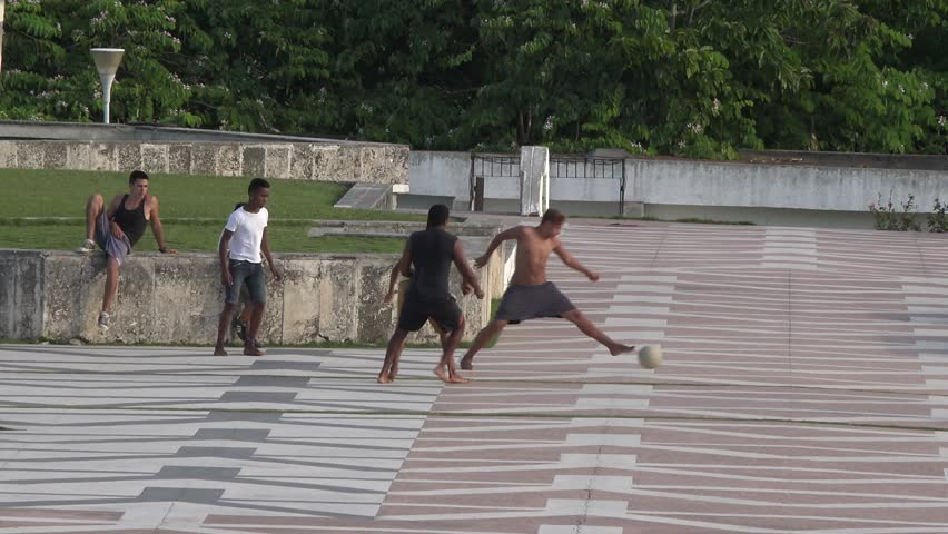 SANTA CLARA,CUBA-JULY 25,2014; Children playing soccer in the Ernesto Che Guevara plaza, mausoleum or memorial. Using the large open space for recreation of the tourist landmark to have fun