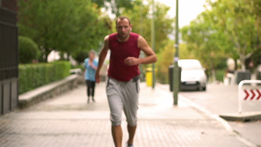 Man resting after running, slow motion shot, steadycam shot  - HD stock footage clip