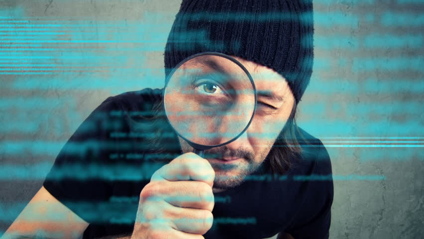 Man looking through magnifying glass and inspecting computer programming code script. 1920x1080 full hd footage.