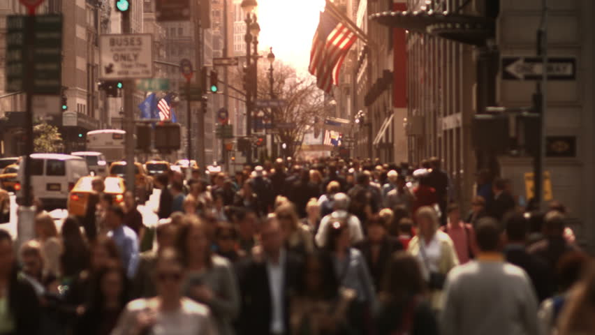 Large crowd of people walking in a big city street. Anonymous crowd. Daytime. High angle. More options in my portfolio. MORE OPTIONS IN MY PORTFOLIO.