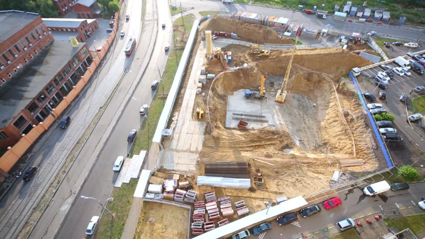 Foundation ditch with machinery at construction site, high angle view.
