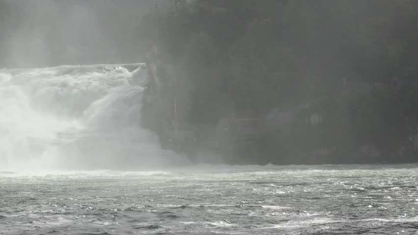 SCHAFFHAUSEN, SWITERLAND - SEPT 2014: Switzerland Rhine Falls beautiful natural waterfall pan. Largest natural river waterfall in Europe. Tourist boats take passengers into the mist. Spectacular view. - 4K stock video clip