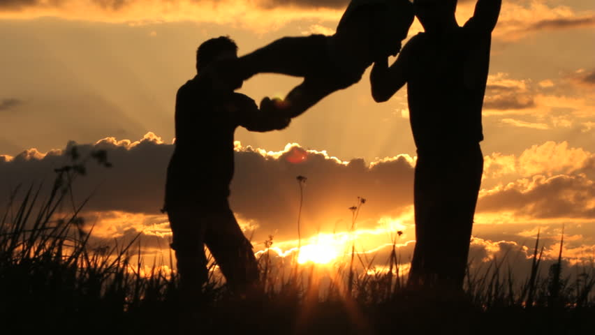 father and  son play. Sunrise. - HD stock video clip