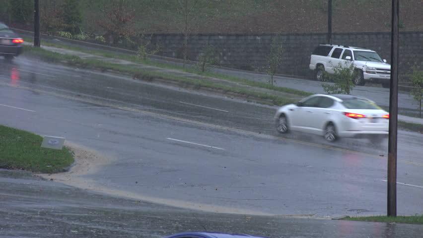 ASHEVILLE, NORTH CAROLINA/USA - OCTOBER 15, 2014: Cars drive through heavy rain after severe storms pass across North Carolina. - 4K stock video clip