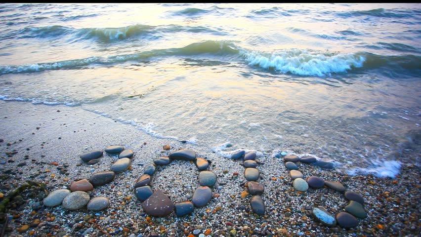 Christmas 2015 made of small stones on the sandy beach. HD. 1920x1080 | Shutterstock HD Video #8051887
