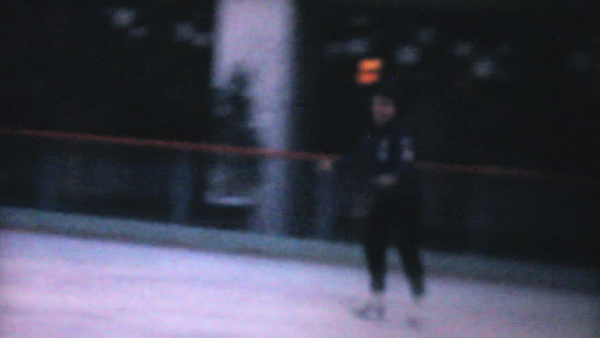 PHILADELPHIA, PENNSYLVANIA, DECEMBER 1962: A teenage girl enjoys practicing leaping and jumping while figure skating at the Penn Center ice rink in downtown Philadelphia in December 1962. - HD stock video clip