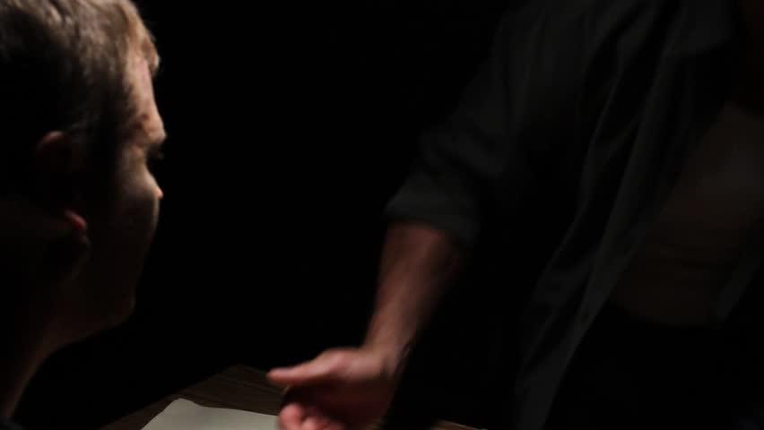 Interrogation detective leaves room