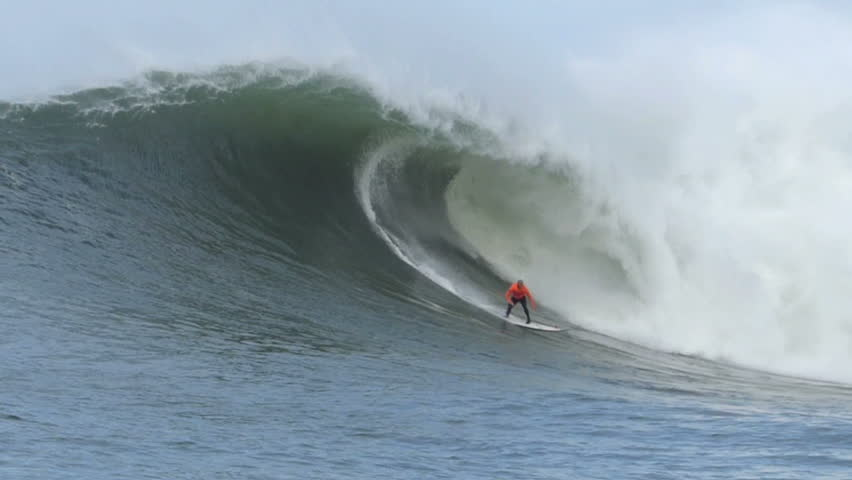 Half Moon Bay, California, USA  Jan. 24, 2014: Professional Surfer, Shane Dorian surfing on a giant wave during the Mavericks Invitational surf competition.