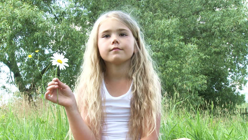 Little girl with chamomile flower  - HD stock video clip